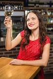 Pretty woman having a glass of wine Royalty Free Stock Photography