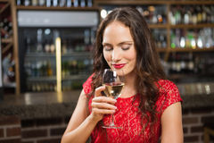 Pretty woman having a glass of wine Royalty Free Stock Photos