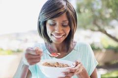 Pretty woman having her breakfast outside Stock Image