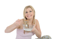 Pretty woman having muesli cereals for breakfast Stock Image