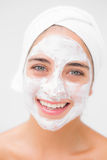 Pretty woman having white cream on her face Royalty Free Stock Photo