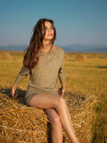 Pretty woman hay bale Stock Photo