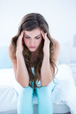 Pretty woman with head ache Royalty Free Stock Photography