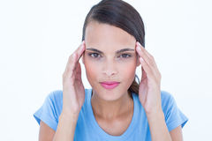 Pretty woman with headache touching her temples looking at camera Royalty Free Stock Photography