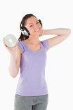 Pretty woman with headphones Royalty Free Stock Photos