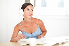 Pretty woman with headphones listening to music Stock Photography