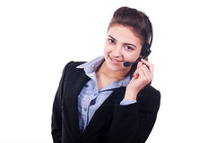 Pretty woman. Pretty  woman with headset smiling during a telephone conversation Royalty Free Stock Images