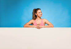Pretty woman with headsets over an empty panel Stock Photo