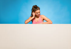 Pretty woman with headsets over an empty panel Royalty Free Stock Photos