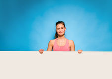 Pretty woman with headsets over an empty panel Stock Photos