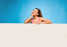 Pretty woman with headsets over an empty panel Stock Photography
