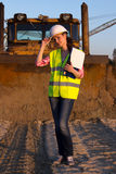 Pretty woman in helmet discusses something Royalty Free Stock Image