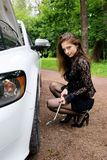 Pretty woman with her broken car Royalty Free Stock Images