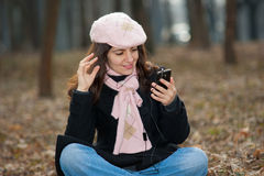 Pretty woman with her cellphone Royalty Free Stock Image