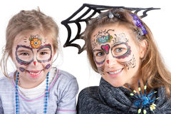 Pretty woman and her daughter in Halloween makeup Royalty Free Stock Image