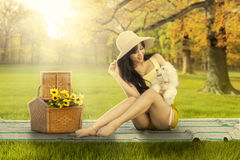 Pretty woman with her dog at autumn park Royalty Free Stock Image