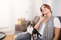 Pretty woman and her dog Stock Image