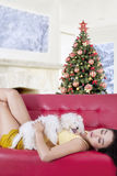 Pretty woman and her dog sleeping on the sofa Royalty Free Stock Images