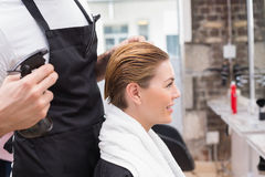 Pretty woman with her hair stylist Stock Photography