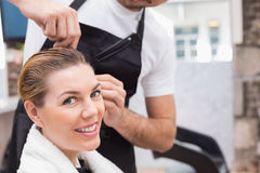 Pretty woman with her hair stylist Stock Image
