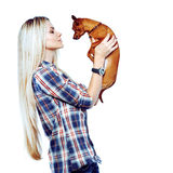 Pretty woman with her little puppy isolated over white background.  stock photo