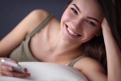 Pretty woman in her living room lying on the couch Stock Photo