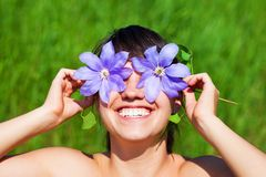 Pretty woman hide her eyes with flowers Royalty Free Stock Images