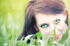 Pretty woman hiding in the grass Stock Image
