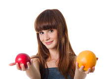 Pretty woman hold apple and orange Stock Photo