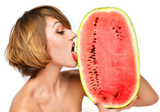 Pretty woman hold in hands and lick fresh red watermelon Royalty Free Stock Image