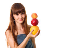 Pretty woman hold some fruits. Studio shot royalty free stock photo