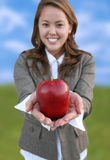 Pretty Woman Holding Apple Royalty Free Stock Images