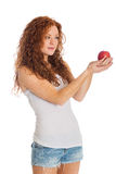 Pretty woman holding an apple Royalty Free Stock Image
