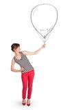 Pretty woman holding balloon drawing. Pretty young woman holding balloon drawing Royalty Free Stock Image