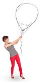 Pretty woman holding balloon drawing Stock Photo