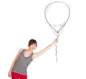 Pretty woman holding balloon drawing. Pretty young woman holding balloon drawing Stock Photography