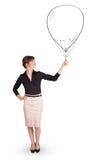 Pretty woman holding balloon drawing. Pretty young woman holding balloon drawing Royalty Free Stock Photo
