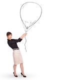 Pretty woman holding balloon drawing Stock Image