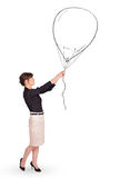 Pretty woman holding balloon drawing Royalty Free Stock Photos