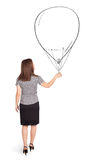 Pretty woman holding balloon drawing Royalty Free Stock Photography