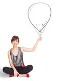 Pretty woman holding balloon drawing Royalty Free Stock Images