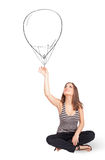 Pretty woman holding balloon drawing Royalty Free Stock Photo