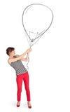 Pretty woman holding balloon drawing Stock Photo