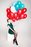 Pretty Woman Holding Balloons Royalty Free Stock Photography