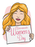 Pretty Woman Holding a Banner with Women's Day Message, Vector Illustration. Beauty blond haired woman holding a banner between her hands with Women's Day Stock Photo