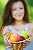 Pretty woman holding basket full Royalty Free Stock Photos
