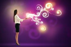 Pretty woman holding beautiful glow Stock Photo