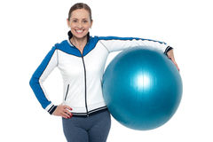 Pretty woman holding big blue pilate ball Stock Photos
