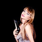 pretty woman holding a black high heel shoe Stock Photos