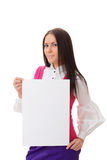 Pretty woman holding blank page. Beautiful girl holding empty poster over white background Stock Image